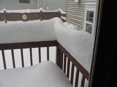A Snowy Deck Railing